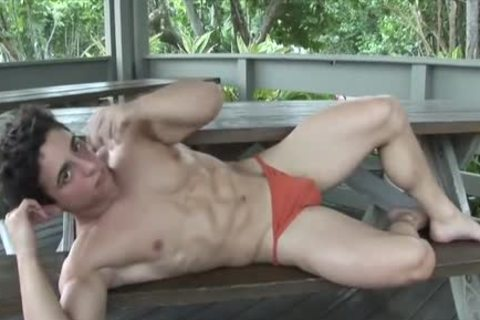 Muscle Hunk Posing In Red underclothing