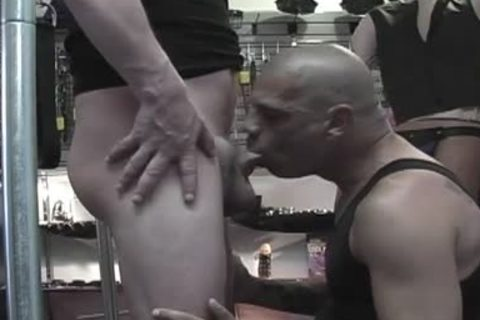 Bald boyfrends sharing oral stimulation stimulation in a sex shop
