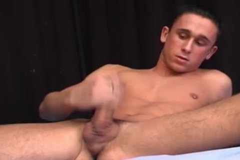 Aroused hunk beating off solo