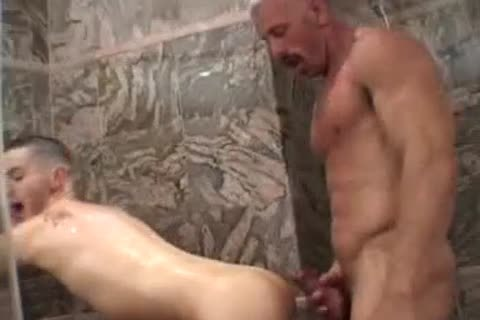 Muscled daddy with palpitating mustache bonks raunchy lad
