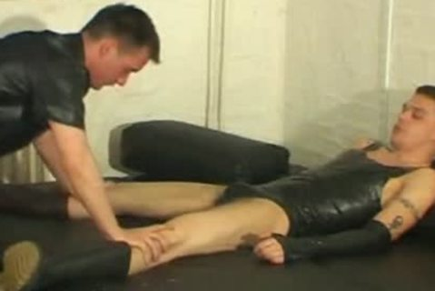 Lewd gay guy sucking latex cock