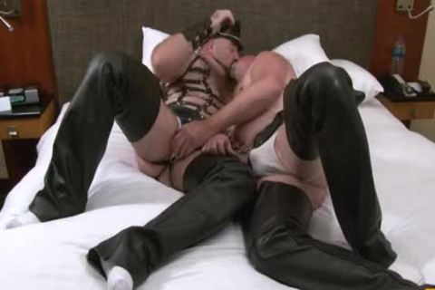 Persons Dressed Up In bondage Gear acquire Each Others Peckers Licked And Suction.