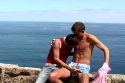 lewd homo legal age teenagers engulfing penis outdoors By The Ocean