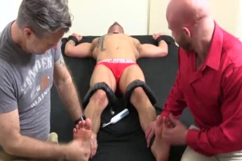 A Super kinky Or Trot Bald chap With Ink receives A hardcore Tickle Session
