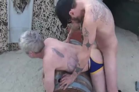 Gay sucking and fucking trio by a fireplace