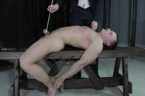 pretty lad tied Down, Balls Strung Up And Spanked