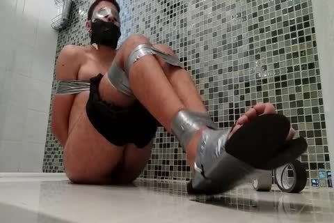 dirty chap In Shorts N Flip Flops Is fastened Gagged N Blindfolded