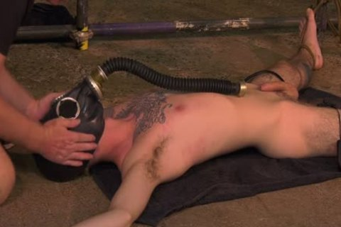 Roped Down twink acquires A Gas Mask And A coarse handjob