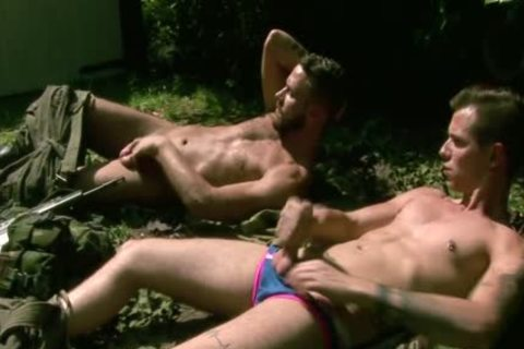 Gogeous Army males stroking outside